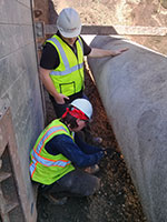 Staff verify the pipe condition