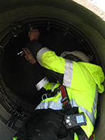 Worker inside a pipe