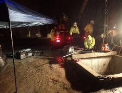 Challenges included nighttime work with traffic control and rain.