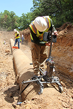 Pure Technologies staff verify the pipe condition