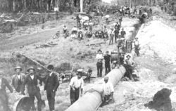 Workers at an old pipeline construction