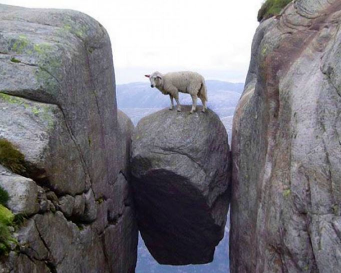 Hanging rock with a sheep above