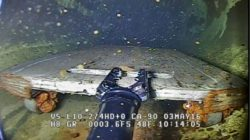 ROV camera shows a tool cart inside the pipe