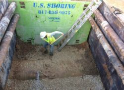 Worker digging to reveal the leak