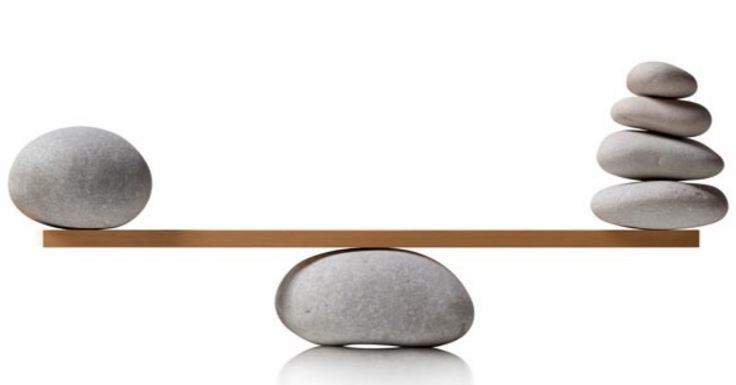 Rocks balanced over a plank of wood